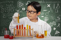 Little scientist with chemical in laboratory Royalty Free Stock Image