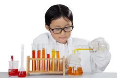 Little scientist experimenting chemical liquid. Picture of little scientist experimenting chemical liquid, isolated on white background Royalty Free Stock Photography