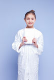 Little scientist girl in a smock with a digital tablet Royalty Free Stock Image
