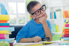 Little scientist with glasses thinking Royalty Free Stock Images