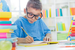 Little scientist with glasses writing Royalty Free Stock Photo