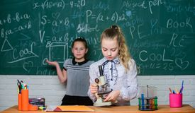 Little scientist work with microscope. Little girls in school lab. Microscope. Testing your blood. Children using stock image