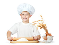 Little scullion is kneading dough Royalty Free Stock Photography