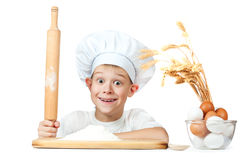 Little scullion is kneading dough Stock Images