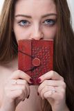 Little secret book of a young woman Stock Photo