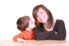Little secrets. Five years boy and his mother - whispering -  isolated on white Stock Photography