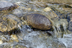 Little seething mountain river with big stones Royalty Free Stock Images