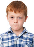 Little serious boy in checkered shirt Royalty Free Stock Photography