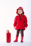 Little serious firefighter on white background Royalty Free Stock Images