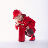 Little serious firefighter on white background Stock Photo