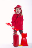 Little serious firefighter on white background. Photo of little funny firefighter on white background Stock Image