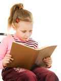 Little serious girl with a book Royalty Free Stock Photo
