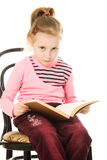 Little serious girl with a book Royalty Free Stock Photos