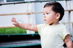 Little serious latin boy outside. Royalty Free Stock Images