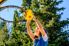Little seven year old girl playing basketball. Little seven year old girl is playing basketball royalty free stock photo