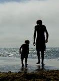 Little shadow boys on the beach stock photo