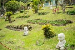 Shaolin Monk Statue in a Garden. Little Shaolin Monk Garden Statue in a Garden stock photo