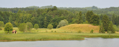 Little shed at a lake. Shed at a lake at Ostersee in Bavaria, Bavarian landscape Stock Image