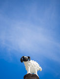 Little sheep statue. In blue sky background Royalty Free Stock Image