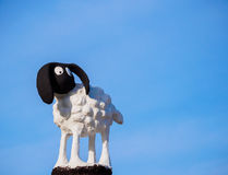 Little sheep statue. In blue sky background Stock Photography