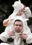 Little sheeps. Father with his son in a sheep dress Royalty Free Stock Photo
