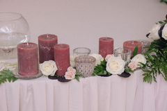 A little shelf, decorated with petals and candles Royalty Free Stock Image