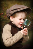 Little Sherlock. Little Boy Playing Sherlock Holmes Detective royalty free stock image