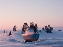 Little ship. On coast of  White Sea, Russia Royalty Free Stock Photos
