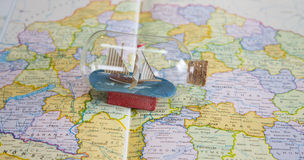 Little Ship in a Bottle on a map. Stock Photography