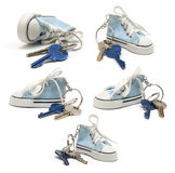 Little shoe ad key chain with keys (set) Royalty Free Stock Images