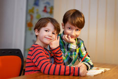 Little shoolboys study together Stock Photos
