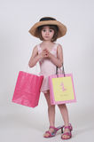 Little Shopper. Three-year-old holding shopping bags Stock Photo