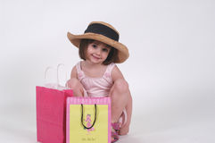 Little Shopper. Three-year-old with shopping bags Royalty Free Stock Photography