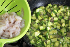 Little shrimps and courgettes. Fresh and raw little shrimps with chopped courgette Royalty Free Stock Photo