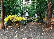 Little shrine in the tree, stone and garden Stock Photography