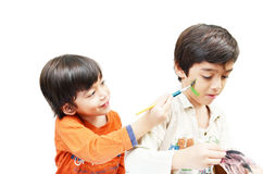 Little sibling boy painting water color Stock Photography