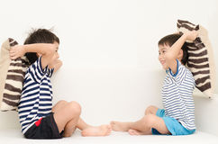 Little Sibling Boy Playing Pillow Fighting On Sofa Stock Photography