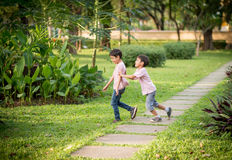 Little Sibling Boy Playing Plane Paper In The Park Outdoor Royalty Free Stock Photo
