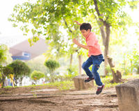 Little sibling boy sitting together in the park outdoor Stock Image