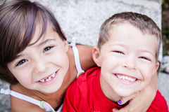 Little siblings with big smiles Stock Photos