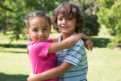 Little siblings hugging each other Royalty Free Stock Image