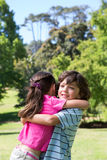 Little siblings hugging each other Royalty Free Stock Photos