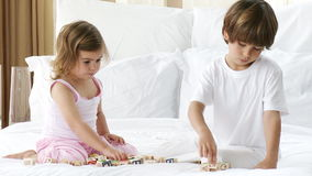 Little siblings playing with toy cubes in bedroom stock video