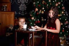 Little siblings waiting for Santa Claus Royalty Free Stock Photo