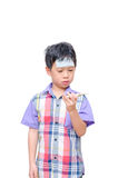 Little sick boy looking at thermometer Royalty Free Stock Photo