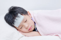 Little sick boy sleeping on bed Royalty Free Stock Photo