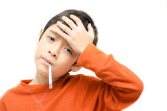 Little sick boy with temperature check thermometer in mouth on white background Stock Photography