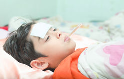 Little sick boy with temperature thermometer in mouth Stock Photography