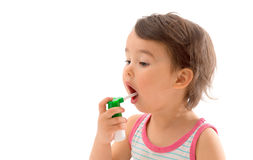 Little sick girl used medical spray for breath isolated Stock Photography