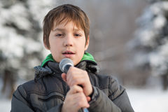 The little singer in a jacket sing outdoors Stock Images